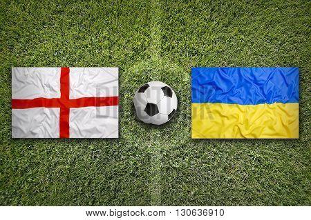 England Vs. Ukraine Flags On Soccer Field