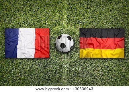 France Vs. Germany Flags On Soccer Field