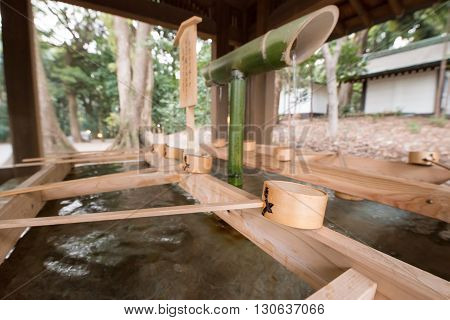 Bamboo water tap and cup for bathing or drinking