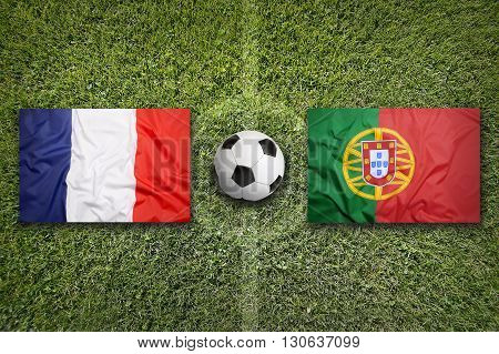 France Vs. Portugal Flags On Soccer Field