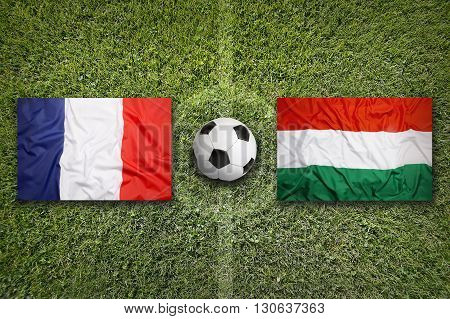 France Vs. Hungary Flags On Soccer Field