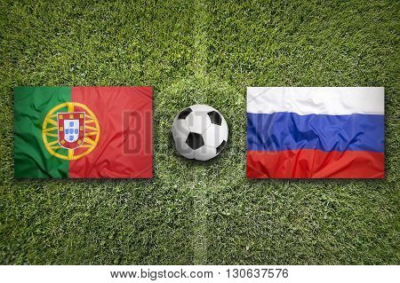 Portugal Vs. Russia Flags On Soccer Field