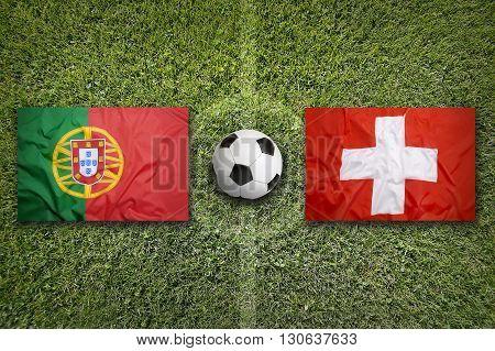 Portugal Vs. Switzerland Flags On Soccer Field