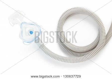CPAP mask and hose on white background with drop shadow to use with CPAP machine for people with sleep apnea