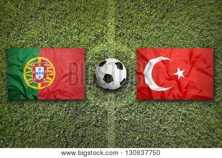 Portugal Vs. Turkey Flags On Soccer Field