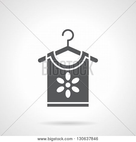 Shirt with flower hanging on hanger. Floral prints in fashion, womens clothing and romantic trend. Shopping symbol. Symbolic black glyph style vector icon.