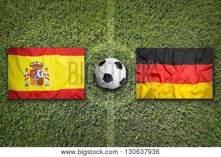 Spain Vs. Germany Flags On Soccer Field