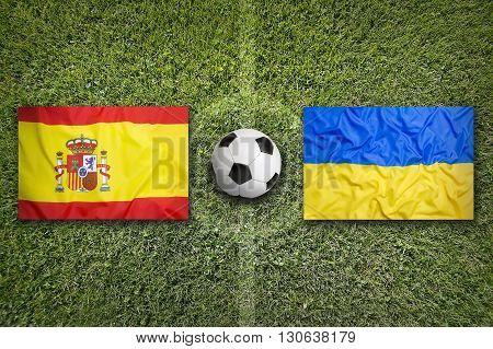 Spain Vs. Ukraine Flags On Soccer Field