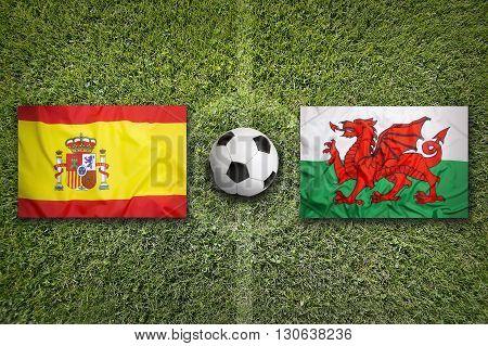 Spain Vs. Wales Flags On Soccer Field