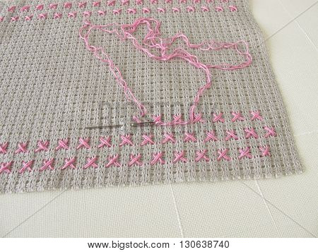 Making of cross stitch pattern on canvas