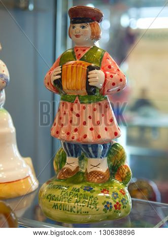 Ceramic figure of a man with accordion