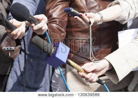 Journalists interviewing spokesman, businessman or politician. News conference.