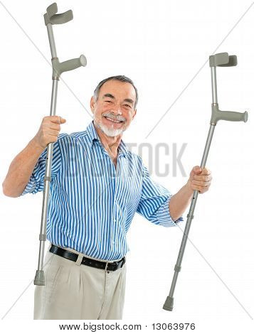 senior man holds the crutches