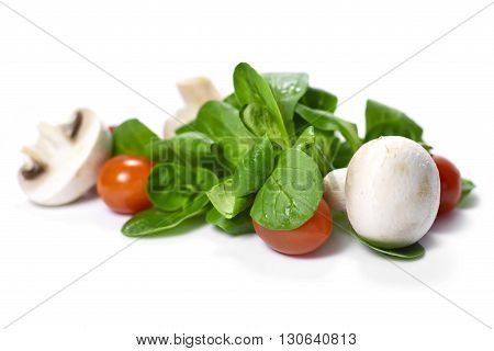 Fresh garden salad, isolated on white background. Corn salad with cherry tomatoes and white mushrooms.