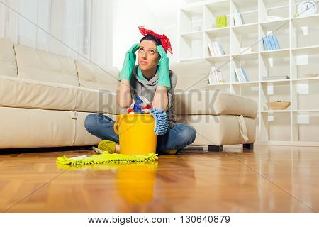 Woman with cleaning supplies in the living room