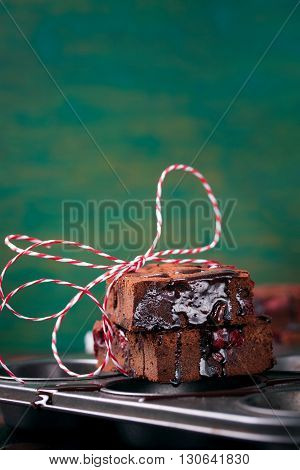 Homemade chocolate sweet brownies cakes with chocolate sauce or syrup on a dark background vertical with place for text