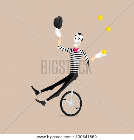 A Mime performing a pantomime - the juggler on a mono cycle