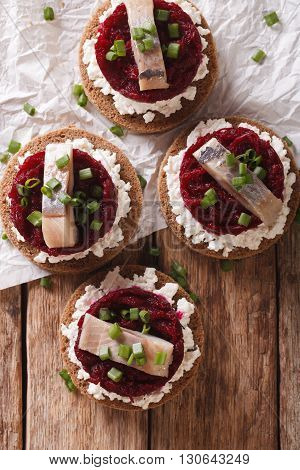 Norwegian Sandwiches With Herring, Beetroot And Cream Cheese. Vertical Top View