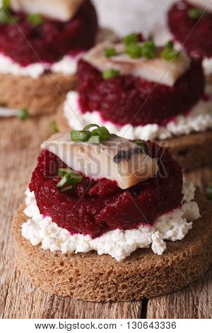 Smorrebrod With Herring, Beetroot And Cheese Close-up. Vertical