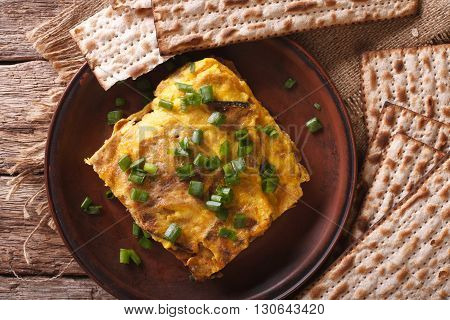 Jewish Breakfast: Matzah Brei With Green Onions Close-up. Horizontal Top View