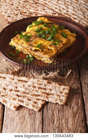 Jewish Omelette: Matzah Brei With Green Onions Close-up. Vertical