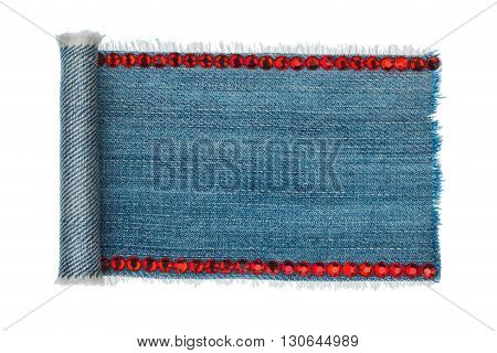 Denim twisted in the form of a manuscript on denim isolated on white background