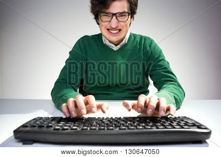 Grinning Man Using Keyboard