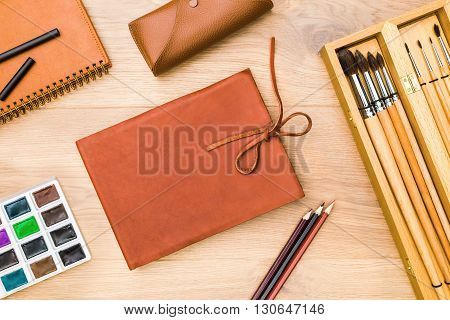 Closed Leather Notepad And Watercolor