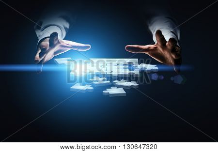 Businessman hands over abstract digital puzzle pieces on dark blue background