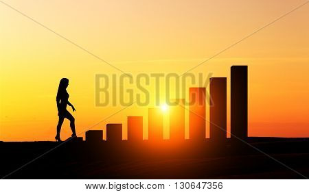 Success concept with businesswoman silhouette climbing chart bars at sunset