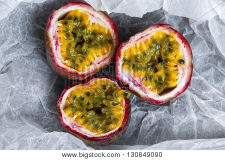 Ripe passion fruit on a crumpled paper.