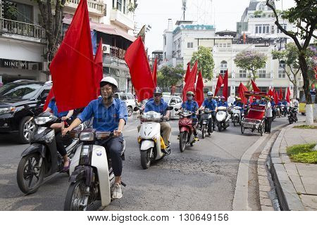 Hanoi, Vietnam - May 21, 2016: Communist party members and their followers running a campaign in Hanoi capital to promote for the coming congress election in all over the country.