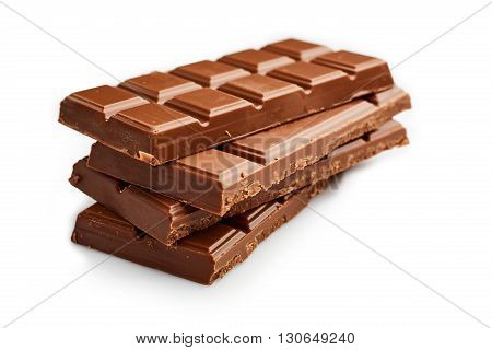 stack of chocolate bars isolated over white seamless background