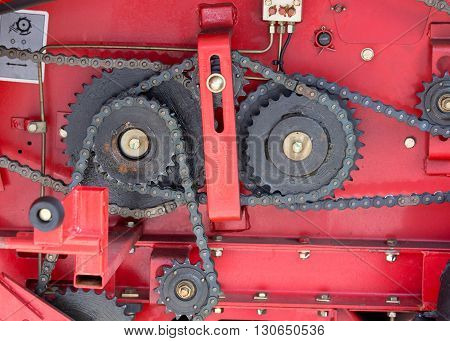 Gears And Chains On Red Background