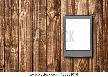 E-book reader on wooden background top view