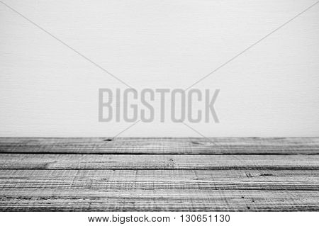 Black and white old wooden table near wall. Shallow depth of field