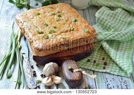 Cake with red rice and meat on the table - tasty still life