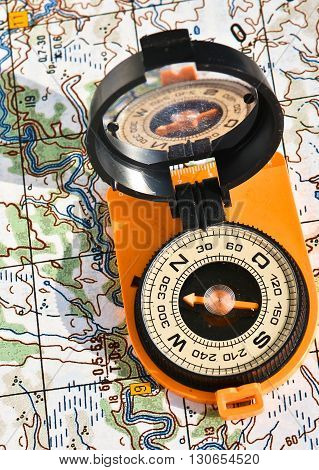 The magnetic compass and topographic map. Travel compass and map symbols adventures.