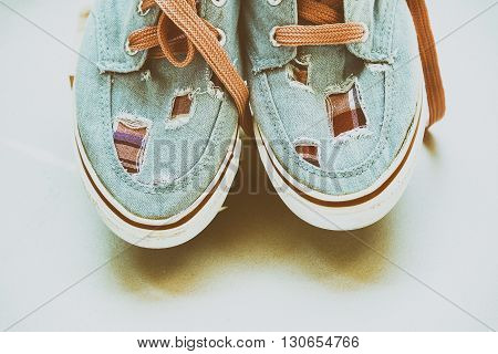 the vintage canvas shoes on the paper background