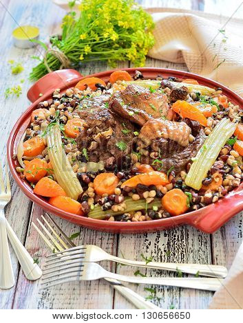 Beans with vegetables and meat on a plate - dinner years