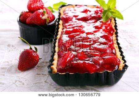 Strawberry jelly topping cheesecake tart top view