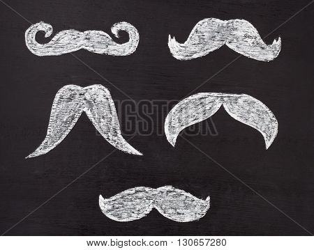 Set Of Moustaches Hand Drawn On Chalkboard