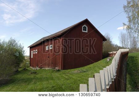 Red and white fence and a red barn from the North of Sweden.