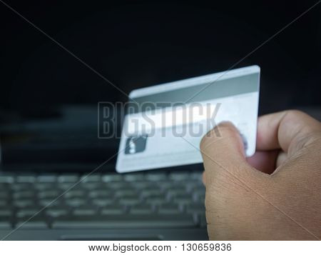 Credit card On-line shopping on the internet using a laptop.