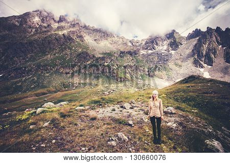 Woman Traveler mountaineering Travel Lifestyle concept Summer vacations outdoor rocky mountains on background moody weather