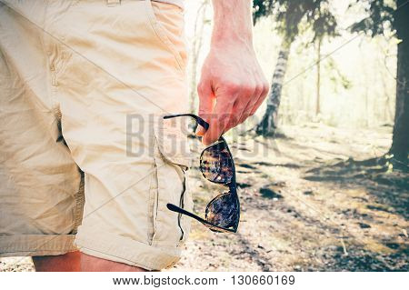 Man walking in shorts clothing hand holding sunglasses Fashion trendy Lifestyle Summer vacations Travel