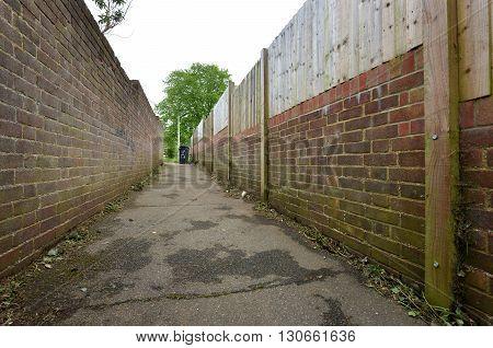 Sinister alley way behind housing estate uk
