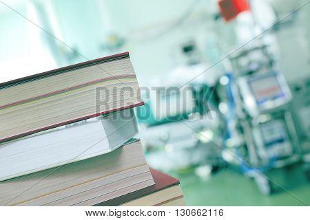 Book on the hospital ICU ward background.