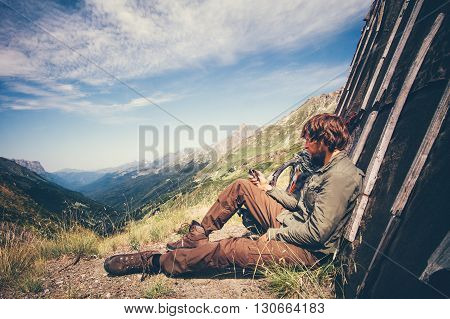 Man Traveler with navigator tracker relaxing alone Travel Lifestyle concept mountains and clouds on background Summer adventure vacations outdoor