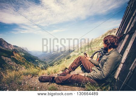 Traveler Man with gps navigator tracker relaxing alone Travel Lifestyle concept mountains and clouds on background Summer adventure vacations outdoor